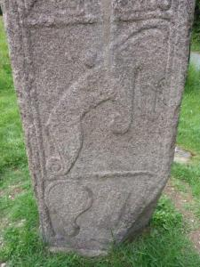 The Maidenstone with Pictish symbols.  Mirror and Comb plus Water Beast, Dolphin or even Elephant